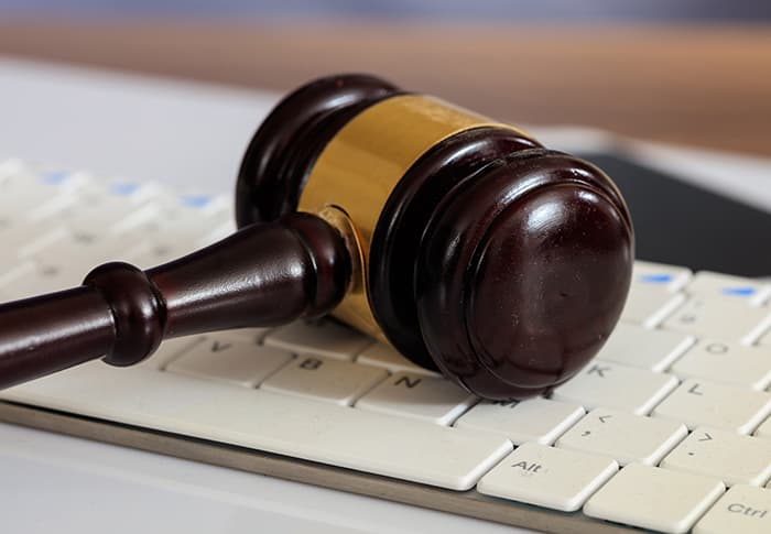 Gavel sitting on a computer keyboard